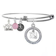 13.1 dangle crystal bangle with add on diva charm.