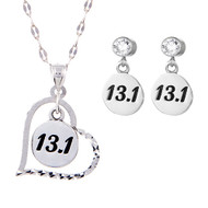 13.1 charm in a heart on chain with 13.1 round earrings on cubic zirconia posts.