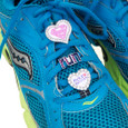 Super girl, run and sole sisters shoelace charms on sneakers