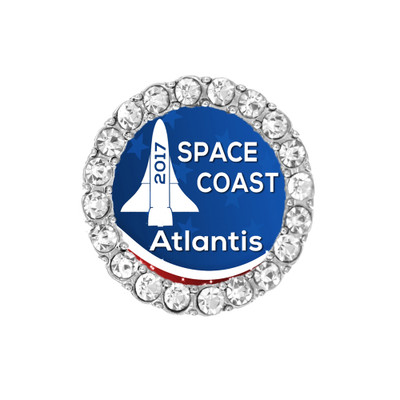 Space Coast 2017 Atlantis Shoelace charm with rhinestones around the side outside.