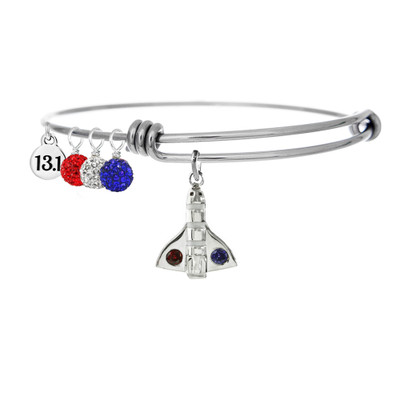 Space Coast Shuttle bangle featuring red, white, and blue crystals and a mini 13.1 charm.