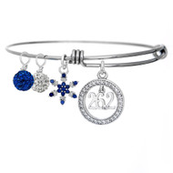 26.2 Cubic Zirconia encircled pendant on an adjustable bangle bracelet with a sapphire studded snowflake and clear and blue pave beads.