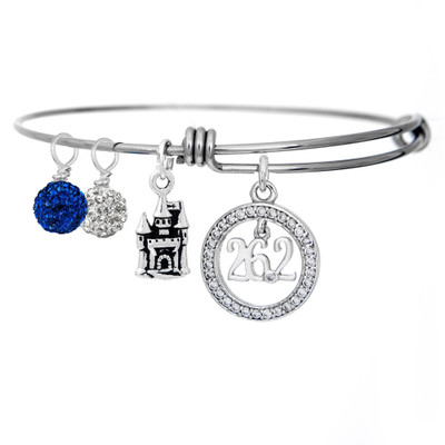 26.2 cubic Zirconia pendant on an adjustable bangle bracelet with a Disney castle charm and 2 sparkling pave crystal drops in blue and white.