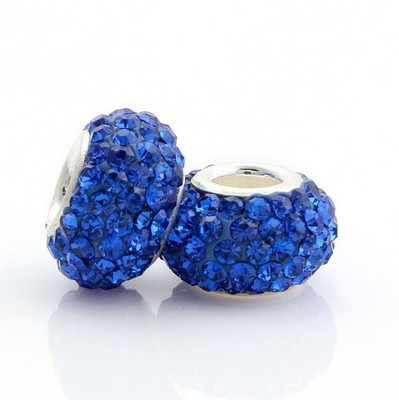 Dark Sapphire Crystal Euroepan beads beside each other.