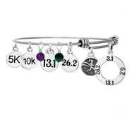 Dopey Distance challenge bangle with 5K, 10K, 13.1 and 26.2 charms and gemstones