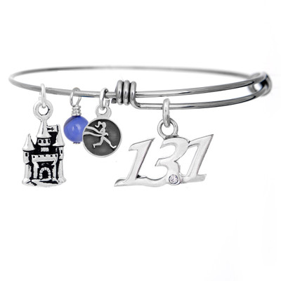 13.1 Script pendant and castle charm on a bangle bracelet.