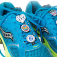 Sneaker charms on running shoes.