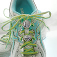 Shoelace charms on running shoes.