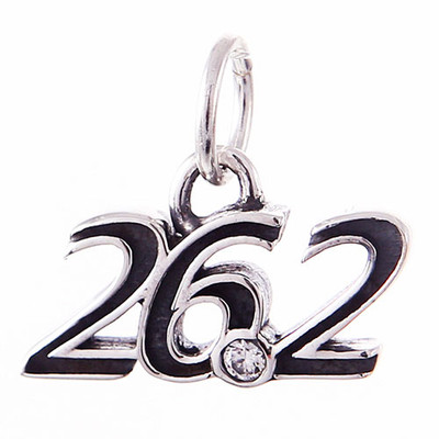 26.2 cursive pendant in Sterling Silver has a CZ at the point.