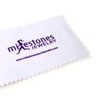 Polish cloth with Milestones Sports Jewelry logo in purple.