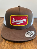 The classic Standard 3/4 mesh trucker hat with Genuine logo sewn on patch. Brown front, white mesh back.