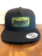 Trucker hat in all black with a camo/black Genuine logo patch.
