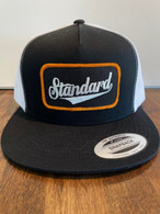 Trucker hat with a black front and white mesh back with a black/white/gold Genuine logo patch.  GO HAWKS!