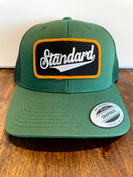 An all green hat in a low profile version, so it fits like a baseball hat.  Green front, green mesh back, Genuine logo patch in black/gold/white.