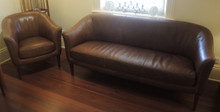 Vintage French Tan Leather 3 seat sofa and two tub chairs.