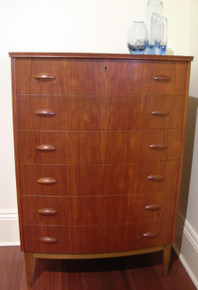 Vintage Danish Modern teak chest of drawers with bow front