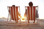 Couple Enjoying A Beach Sunset