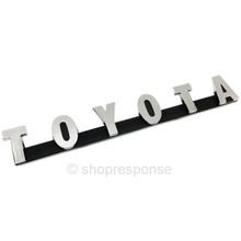 "OEM Toyota 69-74 Land Cruiser FJ40 Front Grill ""Toyota"" Emblem (75321-60010)"