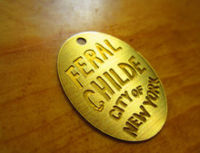 brushed brass metal clothing label