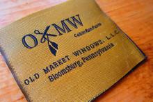 Luminescent woven Florentine yarn label