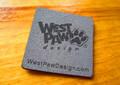 Grey laser etched imitation suede label