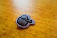 Mini laser cut yarn injection puff label