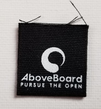 """1""""x 1"""" folded / 1"""" x 2"""" flat black micro organic cotton center fold label. Ideal for beanie hats, sleeves on T's or hemline indentity. 1000pc. min qty order."""