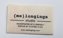 """BCI's printed organic hemp label in center fold shown. Any color print is possible but only 1 color is priced herewith. 1000pc. min qty. size is 2.5"""" x 1.5"""" folded."""