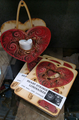 Heartstrings, hanging tealight luminaries kit. Painted wood model kit you punch out and snap together!