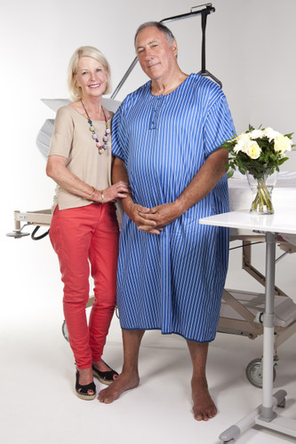 Men's hospital gown with blue with white stripes and a navy blue trim.
