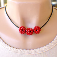 3 red berry cluster bead necklace on black leather cord 16 inch