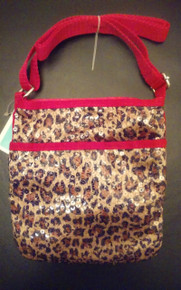 "Your little one will be darling with this fashionable girls leopard print sequin travel crossbody purse. Cute, and affordable too mom!      Features 1 separate zippered pocket for organization in front of purse     Velcro top closure     Adjustable crossbody shoulder strap     Body of bag is, approx. 7.5""L X 7"" W.     Adjustable strap"