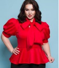 This ruffle bow blouse is available in royal blue, black and red and in sizes 1X, 2X and 3X.