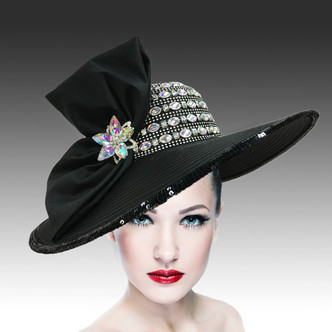 Sensational sweeping picture brim hat with hand embellished jewel crown and titanic bow.