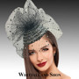 Crystal encrusted fascinator on a headband with a veil sprinkled with sparkles.