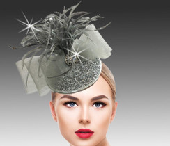 Bead encrusted fascinator with a burst of matching plumes and mesh bow.