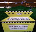 "Whimsical Plaque - ""A messy kitchen is a happy kitchen and this kitchen is delirious."""