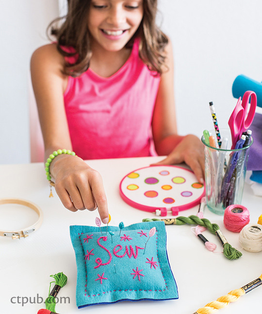 Stitched pillow from The Amazing Stitching Handbook for Kids: 17 Embroidery Stitches • 15 Fun & Easy Projects by Kristin Nicholas #TheAmazingStitchingHandbookforKids