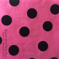 Black dot on pink printed felt