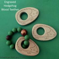 Engraved hedgehog birchwood teether
