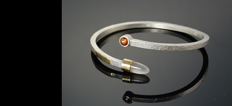 silver bangle with 18kt gold accents, zircon and montana agate