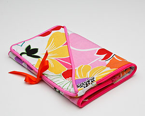judipatuti's Take Along design provides two convenient pockets that are zipped in one contrasting color!  A different, but complimentary, print lines the inside.  Use it to carry your tools on one side and project and beads on the other.  When it's full just fold it in half and tie with the attached ribbons or lay it flat in your Tote Bag.  This little Take Along will serve you well in your studio and when traveling to your favorite beading or sewing retreats!  They also make great gifts! Sun Kissed Take Along will receive many comments from your friends!