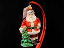 Santa Standing with Decorated Tree