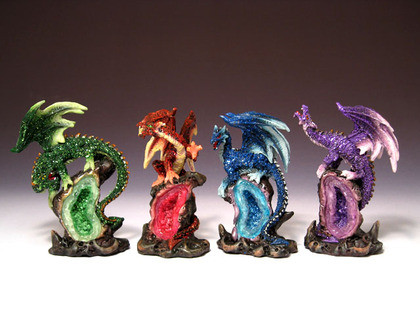 Four assosrted Dragons on faux geode