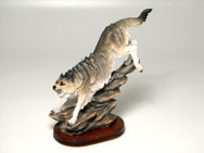 Wolf on wood base
