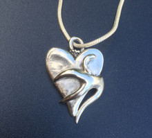 Antler fused to heart. Large piece appx. The size of a Silver dollar