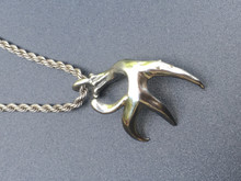 Single 8point shed with drop tine. Large pendant, Silver Dollar sized.   Stainless Steel