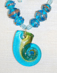 "Close up of ""Shell"" glass pendant"
