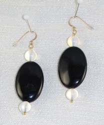 Close detail of drop earrings