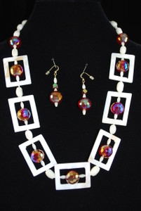 Full view of necklace set on dark background